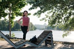 Pretty fit woman outdoor, park, river stock photos