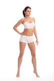Beautiful fit young woman standing white underwear Stock Image