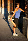 Beautiful fit young woman stretching Stock Photos