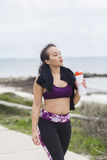 Beautiful fitness athlete woman resting drinking water after workout Stock Image