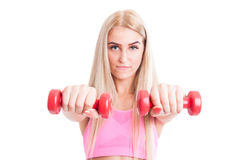 Beautiful fitness female holding weights or dumbbells Royalty Free Stock Images