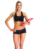 Beautiful fitness girl with a clipboard. Stock Images