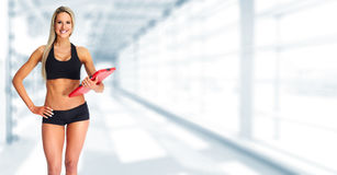 Beautiful fitness girl with a clipboard. Stock Photos