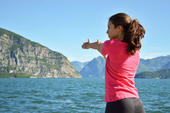 Beautiful fitness girl doing exercises in lake landscape. Girl doing yoga exercise in lake. Stock Photos
