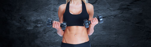 Beautiful fitness girl with dumbbells. royalty free stock photos