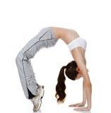 Beautiful fitness girl exercising gymnastic bridge Royalty Free Stock Images