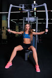 Beautiful fitness girl in a gym royalty free stock photos