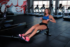 Beautiful fitness girl in a gym royalty free stock image