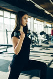 Beautiful fitness girl lifting dumbbells . Fitness sporty girl exercising in gym stock photo