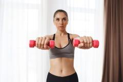Beautiful fitness girl make sport execises stock photo