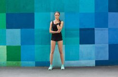Beautiful fitness girl posing on blue background Stock Photography