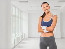 Free Beautiful Fitness Girl Smiling Arms Crossed Stock Photography - 34387472