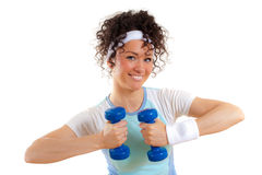Beautiful fitness girl with weights smiling Royalty Free Stock Photography