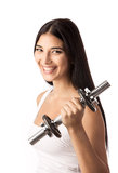 Beautiful fitness girl working out with a dumbbell Stock Image