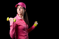 Fitness woman working out biceps Royalty Free Stock Images