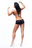 Beautiful fitness model with long black hair. Stock Photography