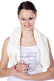 Beautiful fitness model with towel and water Stock Photo