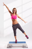 Beautiful fitness model working out Stock Images