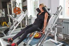 Beautiful fitness model workout, squat Stock Image