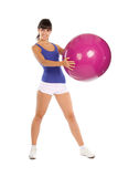 Beautiful fitness trainer. With a big ball Royalty Free Stock Images