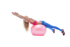 Beautiful fitness trainer exercising with ball Stock Photography