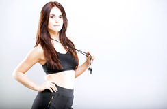 Beautiful fitness trainer in sports bra and whistle Stock Photography
