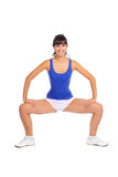 Beautiful fitness trainer squats Royalty Free Stock Photography