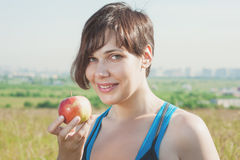 Beautiful fitness woman with apple Royalty Free Stock Image