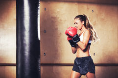 Beautiful Fitness Woman Boxing with Red Gloves Royalty Free Stock Photo