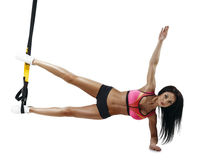 Beautiful fitness woman do trx side plank series Stock Photo