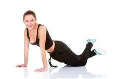 Beautiful fitness woman doing exercise Stock Photos