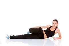Beautiful fitness woman doing stretching exercise Stock Image
