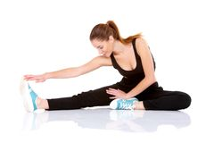 Beautiful fitness woman doing stretching exercise Stock Photos