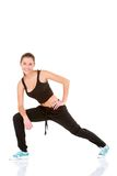 Beautiful fitness woman doing stretching exercise Stock Photography