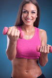 Beautiful Fitness woman doing workout with weights Royalty Free Stock Photos