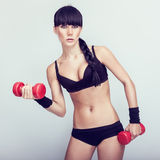 Beautiful  fitness woman exercising Royalty Free Stock Photos