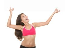Beautiful fitness woman holding sign Stock Photos