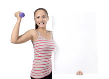 Beautiful fitness woman holding sign Royalty Free Stock Photos