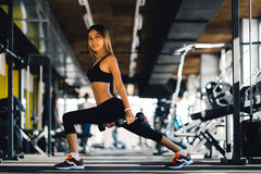 Beautiful fitness woman lifting dumbbells . Fitness sporty girl exercising in gym.  Stock Image