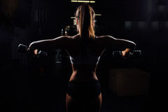 Beautiful fitness woman with lifting dumbbells . royalty free stock photo