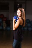 Beautiful fitness woman with lifting dumbbells . Sporty woman lifting light weights. Fit girl exercising building Royalty Free Stock Photography
