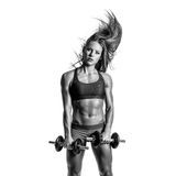 Beautiful fitness woman posing on studio background Stock Images