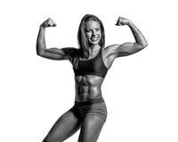 Beautiful fitness woman posing on studio background Royalty Free Stock Images