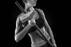 Beautiful fitness woman preparing to lift some heavy weights. Black and white photo Royalty Free Stock Photos
