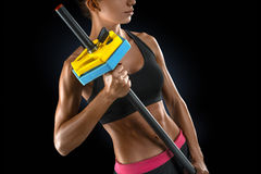Beautiful fitness woman preparing to lift some heavy weights. Close up of beautiful fitness woman preparing to lift some heavy weights Royalty Free Stock Images