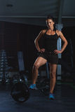 Beautiful Fitness Woman preparing to lift some heavy weights.Female Body builder practising in the gym Royalty Free Stock Photos