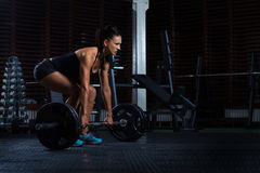 Beautiful Fitness Woman preparing to lift some heavy weights. Royalty Free Stock Image