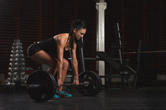 Beautiful Fitness Woman preparing to lift some heavy weights. Stock Images