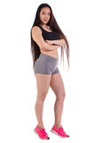 Beautiful fitness woman standing - isolated over a white backgro Royalty Free Stock Image