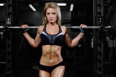 Beautiful fitness woman trains in the gym Royalty Free Stock Images
